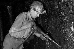 Miner cutting coal underground at Blaencuffin coal mine a privately owned drift mine on mountainside above Pontypool South Wales