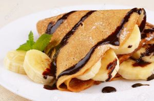 11770860-French-style-crepes-with-banana-chocolate-sauce-and-sugar-powder-Stock-Photo
