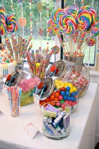 Amazing-Lollipops-and-Round-Candies-in-Fascinating-Candy-Decoration-Ideas-with-Clear-Bowls-and-Jars-on-Wide-White-Table-near-Clean-Glass-Windows