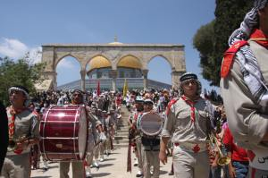 Palestinian scouts take part in celebrat