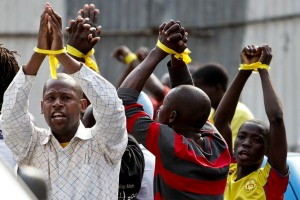 Members of the Patriotic Youth of Angola protest against irregularities in the election process