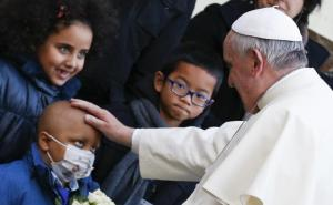 Pope blesses sick child as he arrives to visit Bambino Gesu children's hospital in Rome